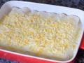 Cubrir de bechamel y queso rallado